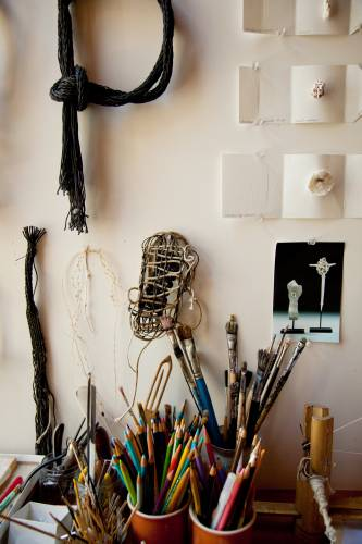 Paint brushes and pencils in studio