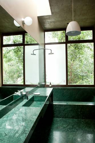 Modernist ensuite bathroom linking to the master bedroom