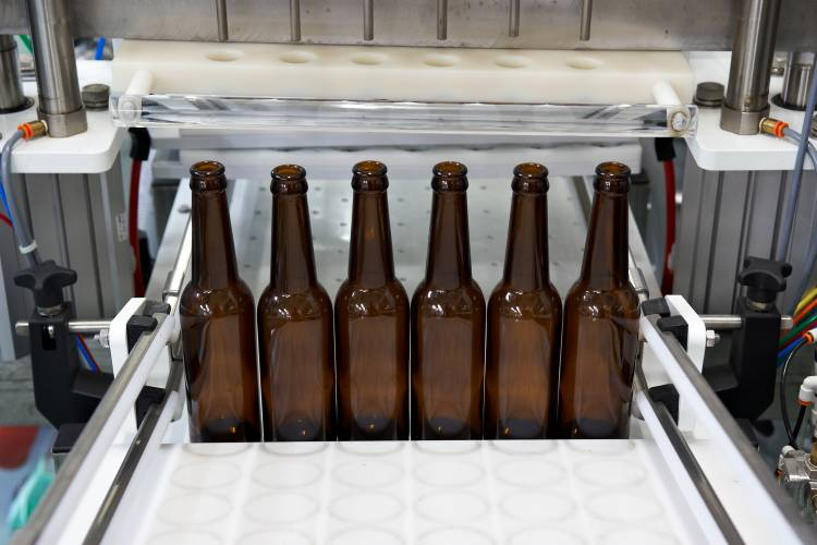 Beers are bottled six at a time