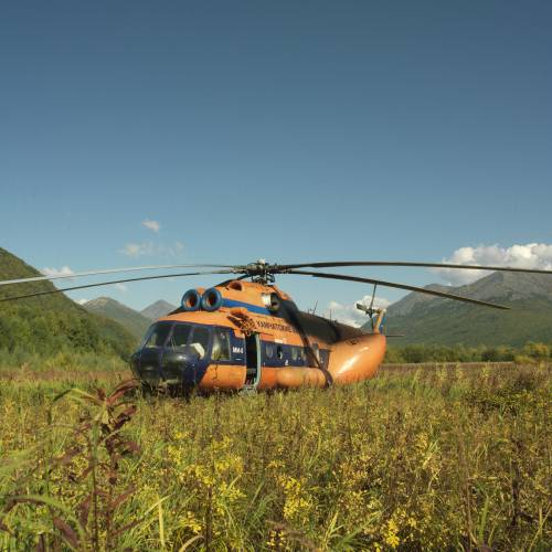 A helicopter unloads fishermen in the Kamchatkan countryside