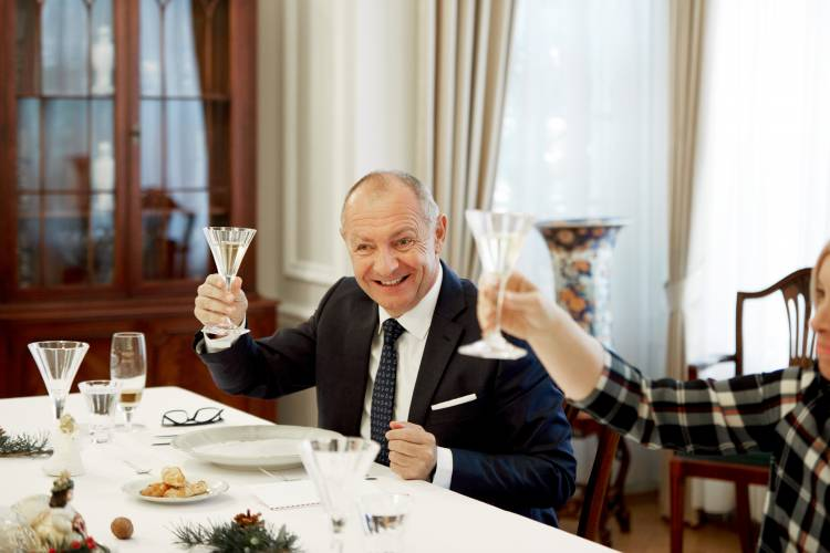 Ambassador Libor Secka raises a glass to toast the season