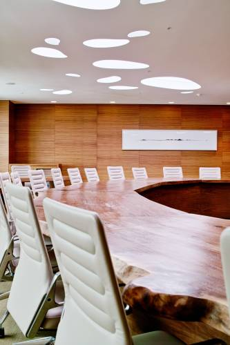 Natural materials are used throughout – the conference room has a custom-made desk and Antonio Citterio's AC 4 chairs for Vitra