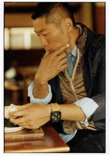 Layered jacket by Sacai, shirt by Engineered Garments Workaday, tie by Engineered Garments, watch by Bell & Ross