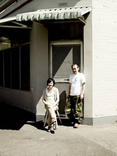 Meg and Zenta Tanaka outside their home, a converted milk bar