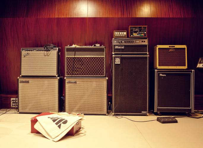 Vintage amps warm up next to the studio's wooden walls